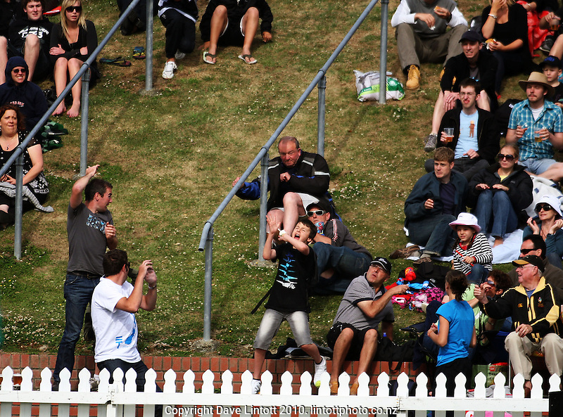 A spectator tries to catch one of Shanan Stewart's sixes during the HRV Cup Twenty20 cricket match between the Wellington Firebirds and Canterbury Wizards at Allied Nationwide Finance Basin Reserve, Wellington, New Zealand on Wednesday, 6 January 2010. Photo: Dave Lintott / lintottphoto.co.nz