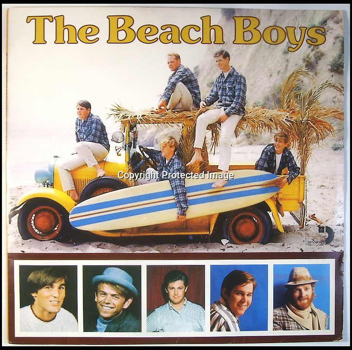 BNPS.co.uk (01202 558833)<br /> Pic: RockawayRecords/BNPS<br /> <br /> ****Please use full byline****<br /> <br /> A surfboard belonging to legendary Beach Boys drummer Dennis Wilson which featured on the covers of two of their most famous albums has emerged for sale for &pound;100,000.<br /> <br /> The iconic blue and yellow board was used for the cover of the Beach Boys' groundbreaking debut album, 1962's Surfin' Safari, and again in 1963 on the front of Surfer Girl.<br /> <br /> Wilson, the band's only surfer, brought the 9ft board along to the band's first ever professional photo shoot held on a beach in California in 1962 shortly after they signed with Capitol Records.<br /> <br /> The five members - Brian, Dennis and Carl Wilson, their cousin Mike Love and friend Al Jardine - were snapped holding it while striking various poses on a beach. The photos from the session went on to become some of the most iconic images of the band.<br /> <br /> Wilson gave the board to his close friend Louis Marotta in the 1970s who in turn passed it on to Beach Boys fan Bob Stafford in 1985.<br /> <br /> Mr Stafford is now selling the board with a whopping price tag of &pound;100,000 after a short stint on display at the Grammy Museum in Los Angeles to mark the band's 50th anniversary.