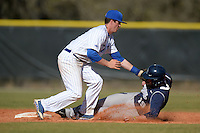 South Dakota State JackRabbits infielder Cody Sharrow (2) tags Steve Anderson (19) sliding in during a game against the Georgetown Hoyas at South County Regional Park on March 9, 2014 in Port Charlotte, Florida.  Georgetown defeated South Dakota 7-4.  (Mike Janes/Four Seam Images)