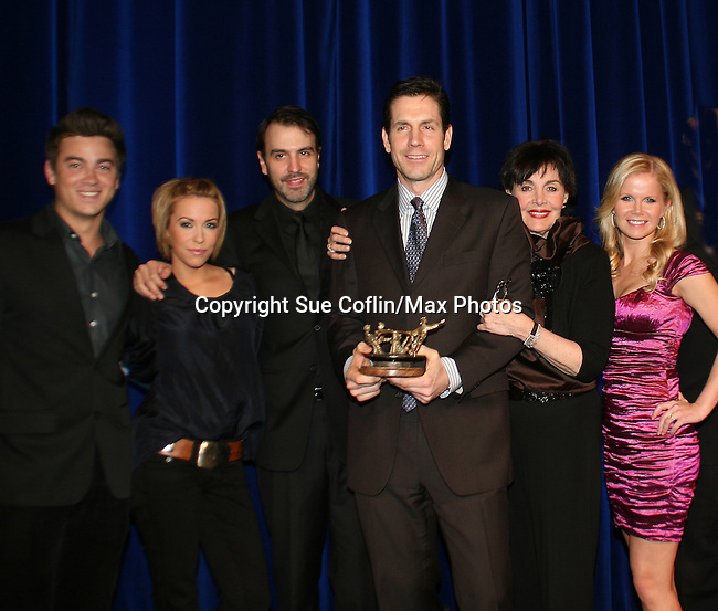 Executive producer of OLTL Frank Valentini receives the Linda Dano Heart Award at the HeartShare Human Services 2009 Spring Gala and Auction on March 24, 2009 at the New York Marriott Marquis, New York City, NY. N photo is Brandon Buddy, Farah Fath, Ron Carlivati (head writer), Frank, Linda Dano, Crystal Hunt(Photos by Sue Coflin/Max Photos)