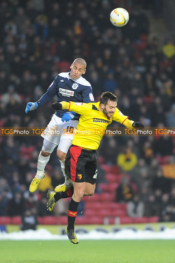 Tommy Miller of Huddersfield Town and Marco Cassetti of Watford go up for a header - Watford vs Huddersfield Town - NPower Championship Football at Vicarage Road Stadium, Watford - 19/01/13 - MANDATORY CREDIT: Anne-Marie Sanderson/TGSPHOTO - Self billing applies where appropriate - 0845 094 6026 - contact@tgsphoto.co.uk - NO UNPAID USE.