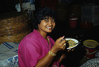 Youg Ledy eating traditional food