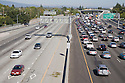 A high angle view of a morning commuter traffic on a northbound Highway 101. A light southbound traffic. Mountain View, California, USA