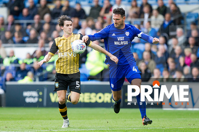 Kieran Lee of Sheffield Wednesday and Sean Morrison of Cardiff City during the Sky Bet Championship match between Cardiff City and Sheffield Wednesday at Cardiff City Stadium, Cardiff, Wales on 16 September 2017. Photo by Mark  Hawkins / PRiME Media Images.