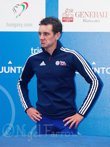 11 SEP 2010 - BUDAPEST, HUN - Alistair Brownlee waits for the start of the medal ceremony after winning the 2010 Elite Mens ITU World Championship Series Triathlon final (PHOTO (C) NIGEL FARROW)