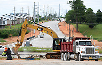 Work continues Tuesday, May 19, 2020, on Gene George Boulevard near Har-Ber Avenue in Springdale. The northern expansion of Gene George Boulevard will run from Bleaux Avenue to Elm Springs Road. Check out nwadg.com/photos for a photo gallery.<br /> (NWA Democrat-Gazette/David Gottschalk)