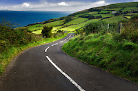 Road near Torr Head with green fields in background. Antrim Coast Northern Ireland