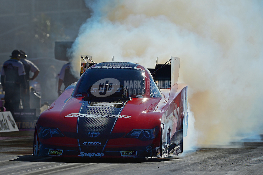Oct. 28, 2012; Las Vegas, NV, USA: NHRA funny car driver Cruz Pedregon during the Big O Tires Nationals at The Strip in Las Vegas. Mandatory Credit: Mark J. Rebilas-