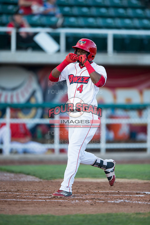 Orem Owlz center fielder D'Shawn Knowles (4) celebrates after hitting a home run during a Pioneer League game against the Ogden Raptors at Home of the OWLZ on August 24, 2018 in Orem, Utah. The Ogden Raptors defeated the Orem Owlz by a score of 13-5. (Zachary Lucy/Four Seam Images)