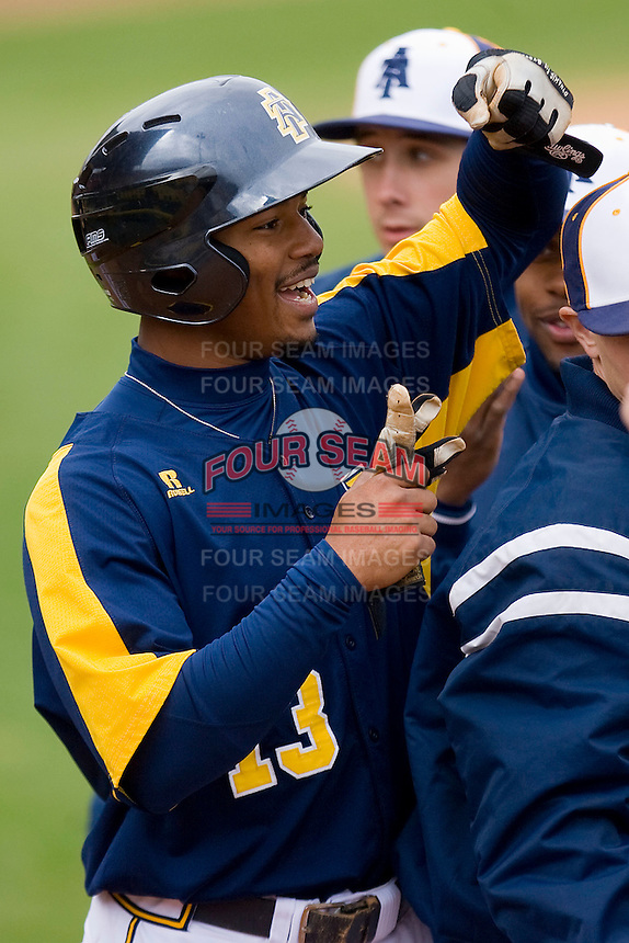 Xavier Macklin #13 of the North Carolina A&T Aggies is greeted by his teammates after scoring a run in the first inning against the High Point Panthers at War Memorial Stadium March 16, 2010, in Greensboro, North Carolina.  Photo by Brian Westerholt / Four Seam Images
