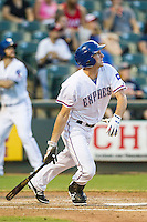 Round Rock Express outfielder Jared Hoying (30) follows through on his swing during the Pacific Coast League baseball game against the Fresno Grizzlies on June 22, 2014 at the Dell Diamond in Round Rock, Texas. The Express defeated the Grizzlies 2-1. (Andrew Woolley/Four Seam Images)