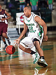 North Texas Mean Green guard Avery Redmond (12) dribbles down court in the game between the Texas State Bobcats and the University of North Texas Mean Green at the North Texas Coliseum,the Super Pit, in Denton, Texas. UNT defeated Texas State 85 to 62