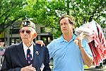 New York State Senator Charles Fuschillo (right) with American flags, and American Legion Post 1282 Adjutant, Robert Tom Riordan (left) a co-chair of the Merrick Memorial Day Parade on Monday, May 28, 2012, on Long Island, New York, USA. America's war heroes are honored on this National Holiday.