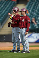 Boston College Eagles head coach Mike Gambino (5) gives instructions to Jake Alu (1) during the game against the North Carolina State Wolfpack in Game Two of the 2017 ACC Baseball Championship at Louisville Slugger Field on May 23, 2017 in Louisville, Kentucky. The Wolfpack defeated the Eagles 6-1. (Brian Westerholt/Four Seam Images)