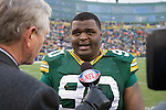 An NFL Network reporter interviews Green Bay Packers defensive lineman B.J. Raji (90) after a Week 11 NFL football game against the Tampa Bay Buccaneers on November 20, 2011 in Green Bay, Wisconsin. The Packers won 35-26. (AP Photo/David Stluka)
