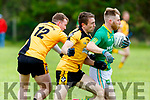Castlegregory's Michael Scanlon been tackled by Shea Doran and Martin Collins of Asdee in the Kerry Petroleum Novice Club Football Championship Semi final in Finuge on Sunday.