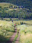 a runner on hill run up mount sentinel trail in missoula, montana