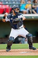 Charlotte Knights catcher Josh Phegley #4 makes a throw to second base against the Toledo Mud Hens at Knights Stadium on May 7, 2012 in Fort Mill, South Carolina.  (Brian Westerholt/Four Seam Images)