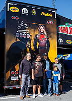 May 7, 2017; Commerce, GA, USA; Fans pose in front of the car hauler of NHRA top fuel driver Leah Pritchett during the Southern Nationals at Atlanta Dragway. Mandatory Credit: Mark J. Rebilas-USA TODAY Sports