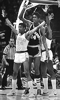 Seven footer Bill Cartwright from Oak Grove High School is guarded by two Berkeley, Ca highschoolers.during the Tournament of Champions March 8,1975 in Oakland. (photo by Ron Riesterer)