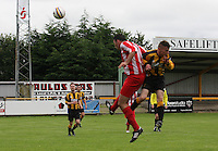 Robert Jamieson wins the aerial dual with Michael Fyfe in the Huntly v Wigtown & Bladnoch William Hill Scottish Cup 1st Round match, at Christie Park, Huntly on 25.8.12.