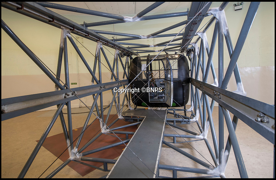 BNPS.co.uk (01202 558833)<br /> Pic: PhilYeomans/BNPS<br /> <br /> The extraordinary machine was built in 1955.<br /> <br /> Sci-fi 'Centrifuge' to open its doors to the public after 64 years...<br /> <br /> A remarkable Cold War relic which has put thousands of pilots through their G-force paces has made its final spin after six decades. <br /> <br /> The Top Secret building at the former RAE Farnborough test site is now open to the public for guided tours led by the scientists from FAST who used to work there.<br /> <br /> The Farnborough Centrifuge was used to simulate huge 9G forces - nine times more than a human body is designed to absorb - they would encounter while flying fast jets during combat operations.<br /> <br /> The pilot would sit in a small compartment replicating a cockpit at the end of the 60ft rotating arm and be propelled at over 60mph, spinning 30 times a minute.<br /> <br /> A staggering 122,133 tests were performed on it before it was decommissioned in March this year, with a new centrifuge installed at RAF Cranwell.<br /> <br /> It featured on an episode of Top Gear in 2000 when Jeremy Clarkson had a go on it at 3G, leaving him in obvious discomfort. He described the force exerted on him as like 'having an elephant sat on my chest'.<br /> <br /> The centrifuge, which is being displayed for the public for the first time, also appeared in the 1985 comedy film Spies Like Us starring Chevy Chase and Dan Ackroyd.