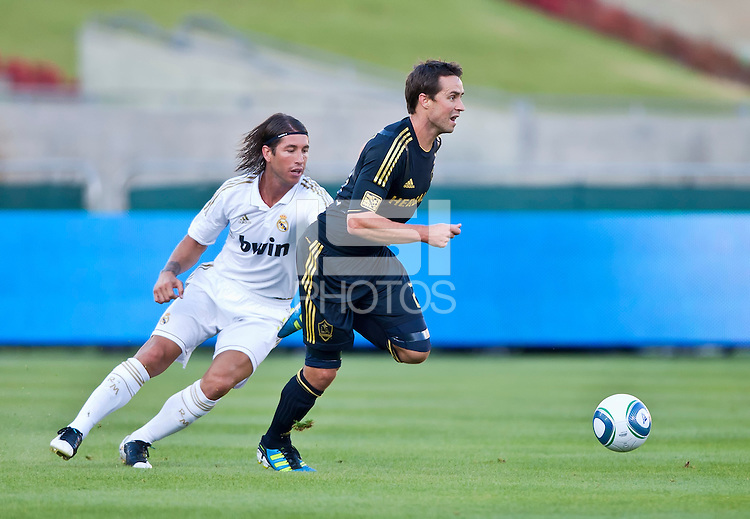 LOS ANGELES, CA – July 16, 2011: Todd Dunivant (2) of the LA Galaxy and Sergio Ramos (4) of Real Madrid during the match between LA Galaxy and Real Madrid at the Los Angeles Memorial Coliseum in Los Angeles, California. Final score Real Madrid 4, LA Galaxy 1.