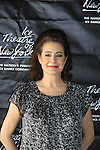 actress Sean Young competes at Ice Theatre of New York's Celeb Skate 2013 on June 9, 2013 at the Sky Rink at Chelsea Piers, New York City, New York. She was a contestant of Skating with the Stars. (Photo by Sue Coflin/Max Photos)