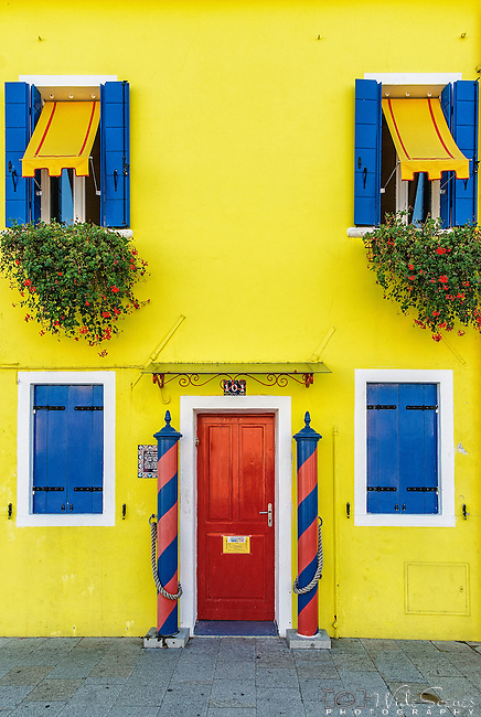 One of the many brightly coloured houses on the island of Burano in the Venetian Lagoon in Italy. The island is well known for its colourful houses and its lacework. For more info please visit http://en.wikipedia.org/wiki/Burano