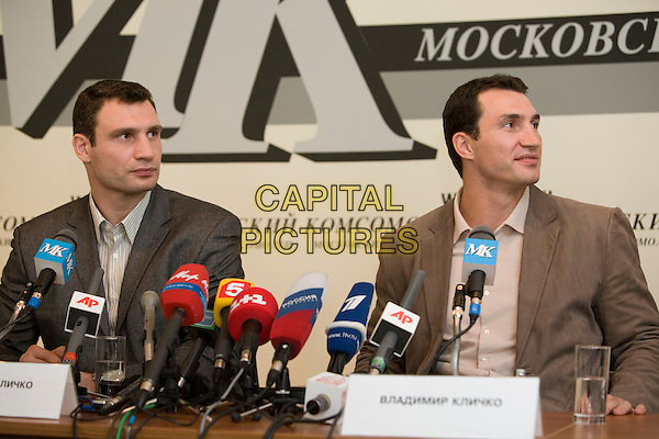 Vitali Klitschko, Wladimir Klitschko .Press conference in the newspaper the Moscow member of the Komsomol, Russia..March 15th, 2007.half length microphone grey gray suit jacket half length brown shirt .CAP/PER/AM.©AM/PersonaStars/CapitalPictures