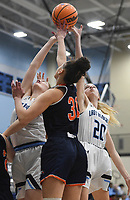 Har-Ber Claire Doty (31) and Har-Ber forward Mary Blake Martfeld (20) reach for a rebound, Friday, February 7, 2020 during a basketball game at Wildcat Arena at Har-Ber High School in Springdale. Check out nwaonline.com/prepbball/ for today's photo gallery.<br /> (NWA Democrat-Gazette/Charlie Kaijo)