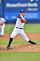 Asheville Tourists pitcher Nick Kennedy (21) delivers a pitch during a game against the Augusta GreenJackets at McCormick Field on April 7, 2019 in Asheville, North Carolina. The GreenJackets  defeated the Tourists 11-2. (Tony Farlow/Four Seam Images)