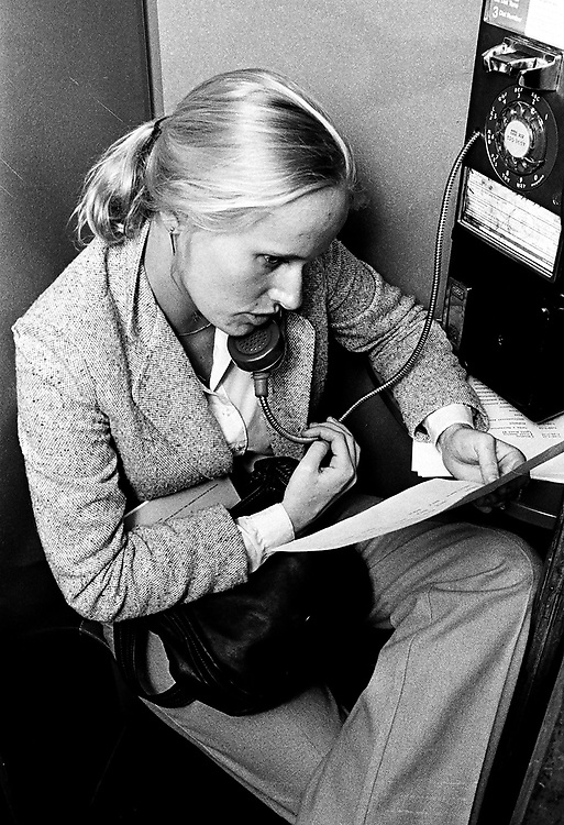 An unidentified reporter (preseumed to be working for Newsday) on the phone in an undated photo by Jim Peppler.