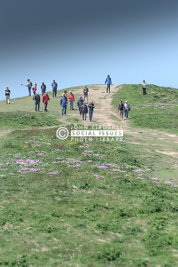 Walkers on East Pentire Headland in Newquay, Cornwall.