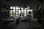 """Gaza.10.01.2008Palestinian worker inspects a damaged classroom at the American School in Gaza City 10 January 2008. The school was hit by a rocket propelled grenade (RPG) around midnight by unknown assailants.""""photo by Fady Adwan"""