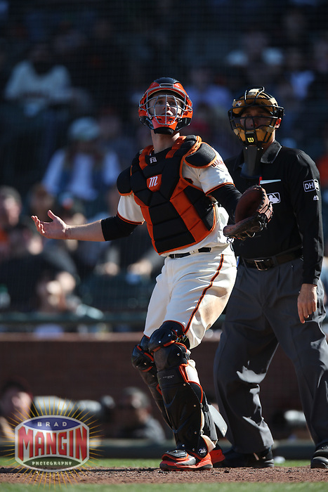 SAN FRANCISCO, CA - APRIL 29:  Buster Posey #28 of the San Francisco Giants looks for a foul pop up against the Los Angeles Dodgers during the game at AT&T Park on Sunday, April 29, 2018 in San Francisco, California. (Photo by Brad Mangin)