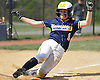 Amanda Considine #1 of Massapequa slides home safely in the bottom of the second inning of a Nassau County varsity softball game against East Meadow at Berner Middle School on Monday, Apr. 25, 2016. Massapequa won by a score of 6-4.