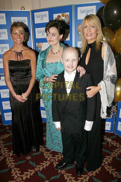 ALEX BEST, CHERIE BLAIR & GABBY ROSLIN.The Chocolate Ball in aid of sargent Cancer Care for Children at the Cafe Royal, Picadilly.11 March 2004.full length, full-length.www.capitalpictures.com.sales@capitalpictures.com.©Capital Pictures