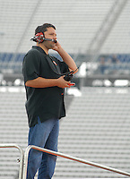 June 2, 2006; Dover, DE, USA; Nascar Nextel Cup driver Tony Stewart watches as Ricky Rudd (20) runs his car during practice for the Neighborhood Excellence 400 at Dover International Speedway. Rudd is replacing regular Stewart who is recovering from injuries in last weeks race. Mandatory Credit: Mark J. Rebilas..