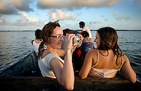 Spanish tourists enjoy a sunset on a boat ride back from a trip around the Pearl Lagoon on the Atlantic Coast on Nicaragua in April, 2009.