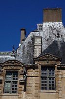 A particular of the Hotel de Sully, in the Marais, Paris. It is a part of the roof, arranged in mansards. The building dates back to the XVII century. Digitally Improved Photo.