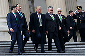 From left to right, United States Speaker of the House of Representatives Paul Ryan, Republican of Wisconsin,  Prime Minister of Ireland Leo Varadkar, United States President Donald J. Trump, Representative Peter King, Republican of New York, and United States Vice President Mike Pence, walk down the steps of the United States Capitol following the Friends of Ireland luncheon at the United States Capitol in Washington, D.C. on March 15, 2018. Credit: Alex Edelman / CNP