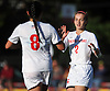 Sacred Heart No. 2 Caitlin Kennedy, right, gets congratulated by teammate No. 8 Kerri Bradley after scoring a goal in the ninth minute of a CHSAA varsity girls' soccer game against St. John the Baptist at Sacred Heart Academy on Monday, October 5, 2015. Kennedy scored all three of her team's goals in Sacred Heart's 3-1 win.<br /> <br /> James Escher