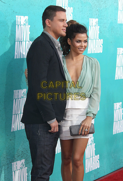 Channing Tatum & Jenna Dewan.2012 MTV Movie Awards held at the Gibson Amphitheatre, Universal City, California, USA..3rd June 2012.half 3/4 length jacket jeans denim black white grey gray white skirt green blouse top plunging neckline cleavage married husband wife clutch bag.CAP/ADM/SLP/LS.©Lee Sherman/Starlitepics/AdMedia/CapitalPictures.
