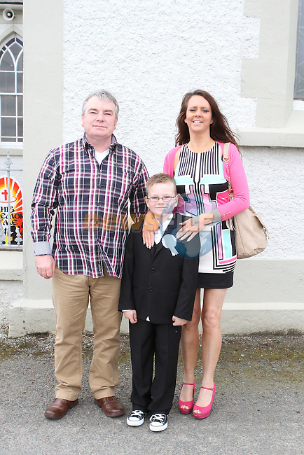 Leon McGovern with his parents at Phillipstown Communion in St.Kevins Church...(Photo Jenny Matthews/www.newsfile.ie)