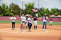 Women's basketball seniors throwing out the first pitch.<br />  (photo by Beth Wynn / &copy; Mississippi State University)