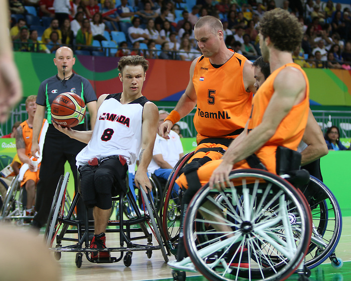 RIO DE JANEIRO - 09/09/2016: Canadian men's wheelchair basketball team competes in the preliminaries against NED at the Rio 2016 Paralympic Games at Carioca Arena 1. (Photo by Lindsay Crone/Canadian Paralympic Committee)