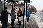 Residents wait at the bus stop in the Ronna neighborhood, where Syrian and Iraqi refugees are concentrated in Södertalje, Sweden, Nov. 6, 2014. Södertalje is known for its open-door policy toward refugees, especially mostly Christian Syrians and Iraqis, who make up 30,000 of the town's 90,000 residents. Since the Syrian war began three years ago, the town has seen a marked increase in Syrian refugees resettling in Södertalje, and seeking housing, education, and other services.