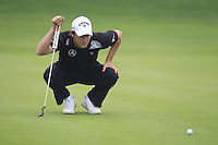 Emiliano Grillo (ARG) on the 5th green during Saturay's Round 3 of the 2014 BMW Masters held at Lake Malaren, Shanghai, China. 1st November 2014.<br /> Picture: Eoin Clarke www.golffile.ie