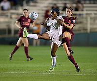 Jamia Fields (4) of Florida State fights for the ball with Danielle King (8) of Virginia Tech during the Women's College Cup semifinals at WakeMed Soccer Park in Cary, NC. Florida State defeated Virginia Tech, 3-2.